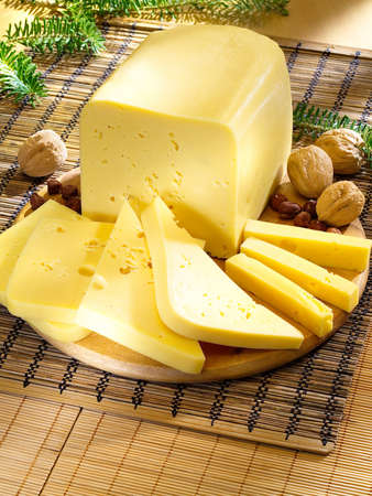 Ararangement with cheese on the kitchen cutting board  Stock Photo