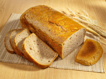 life loaf: Freshly baked bread and wheat on table Stock Photo