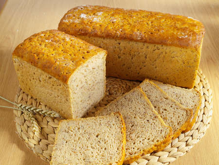 Freshly baked bread and wheat on table Stock Photo - 13865809