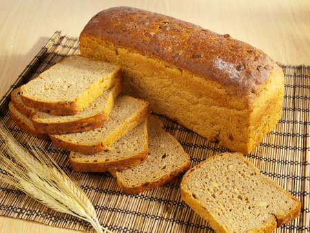 life loaf: Freshly baked bread with soybeans and wheat on table
