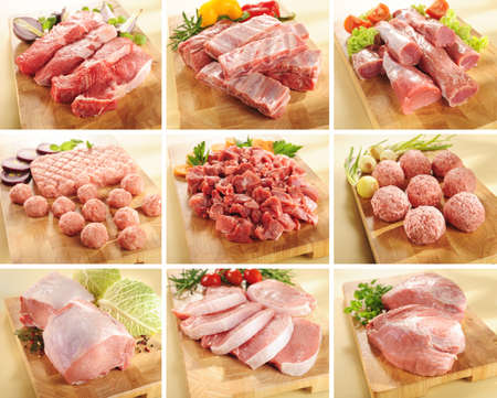 Various types of pork and beef meats on cutting boards Foto de archivo