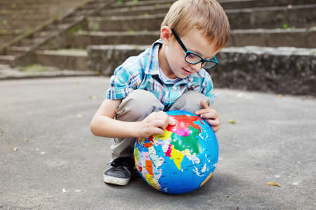 going places: Time for school - Kid with globe