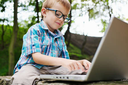 delighted: Boy delighted with laptop