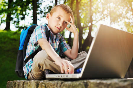 internet explorer: Thoughtful boy with laptop Stock Photo