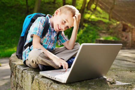 internet explorer: Smiling boy with laptop  Stock Photo