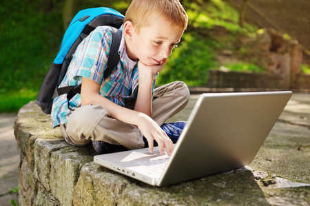 internet explorer: Boy delighted with laptop