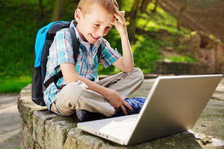 delighted: Boy delighted with notebook Stock Photo