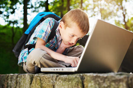 Boy focused on notebook photo