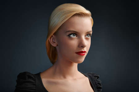 blonde teenager: Beautiful blonde girl with red lips and modern haircut