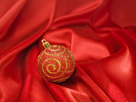 Beautiful red christmas ball on red fabric Stock Photo - 16641863