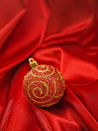 Beautiful red christmas ball on red fabric Stock Photo - 16641864