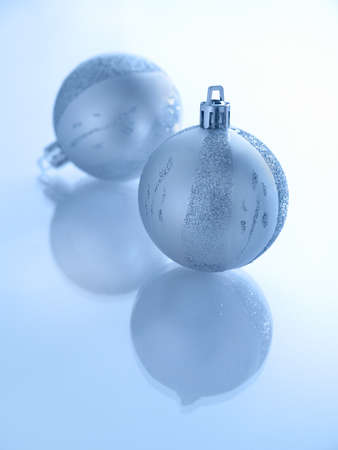 Beautiful Blue Christmas Balls on mirrored plain background photo