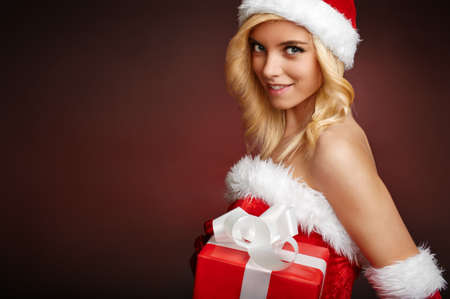 Cute santa claus girl with gift box Stock Photo - 16698035