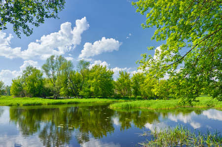 Spring landscape with Narew river and clouds on the blue sky photo