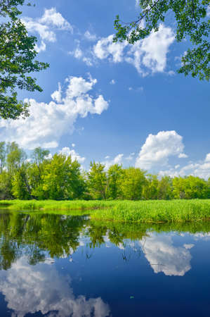 Summer landscape with Narew river and clouds on the blue sky photo