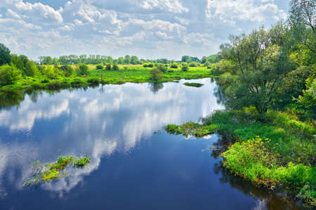 narew: Spring landscape with Narew river and clouds on the sky