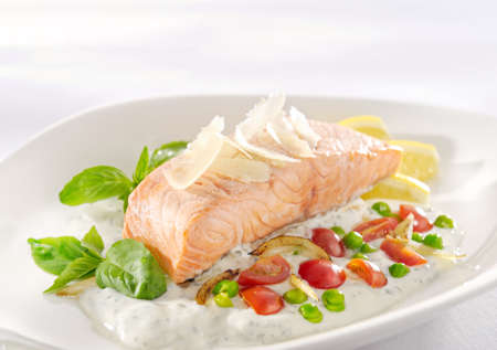 salmon dinner: Dinner with delicious salmon in cream on a white plate Stock Photo