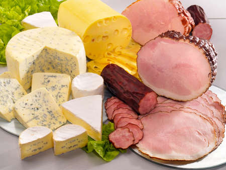 dairy: Ararangement with cheese, ham and sausage on table Stock Photo