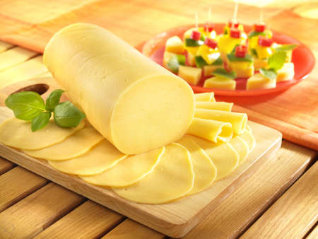 Salami cheese on kitchen board with