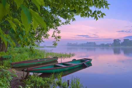 Two boats on Narew river  Sunrise landscape