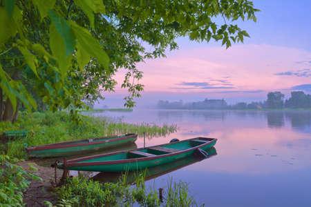 Two boats on Narew river  Sunrise landscape
