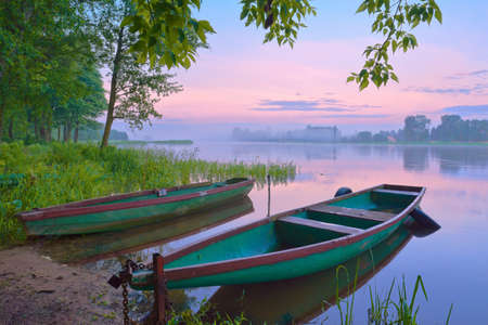 swamp: Two boats on Narew river  Sunrise landscape