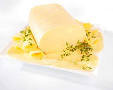 Fresh yellow gouda cheese on a plate