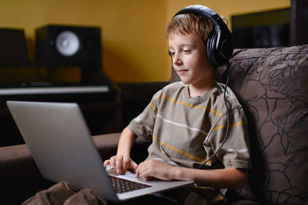 Young boy listening to music and browsing the wireless internet photo