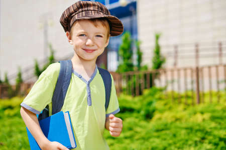 book bags: Young kid is going to school