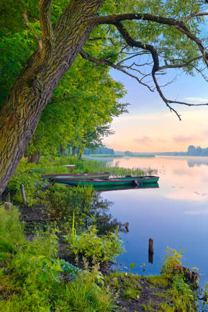 Two boats on The Narew river. Sunrise landscape.