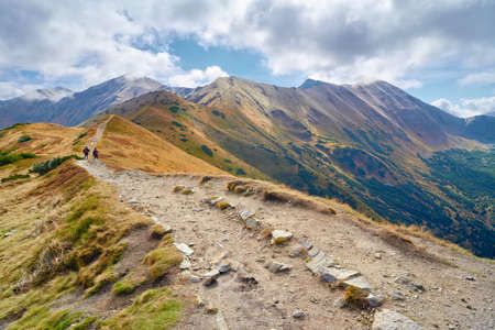 High mountains in Europe  Tatras, Poland  Nature preserve  Tourists on trail from Trzydniowianski Wierch  1758 m  to Konczysty Wierch  2002 m   photo