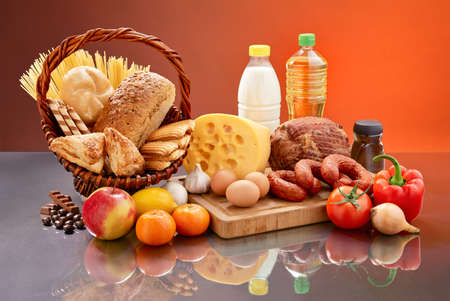 foodstuff: Many daily food ingredients  Set of tasty groceries on mirrored table  Various comestible products