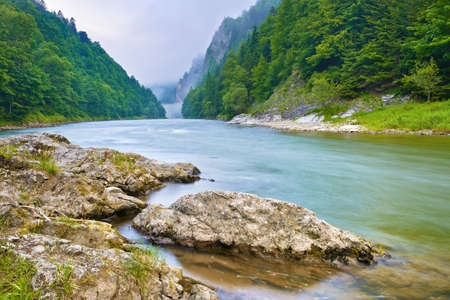 Stones on the riverbank in the mountains  The Dunajec River Gorge, Pieniny  Poland and Slovakia national border  photo