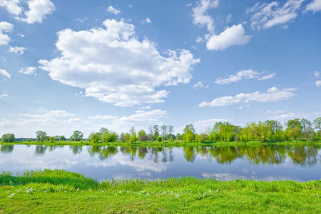 Sunny spring landscape  Clouds on the blue sky over The Narew River