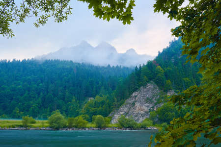 Foggy morning by The Dunajec River Gorge in The Pieniny Mountains  Nature reserve  The Three Crowns Massif view from Slovakia  photo
