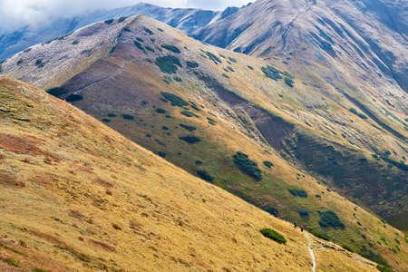 Tourists on mountain trail  The West Tatra Mountains, Carpathians  Nature reserve
