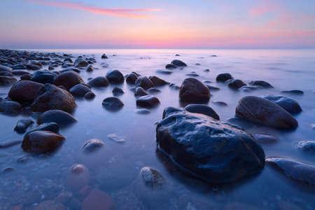 Beautiful seascape with coastal stones in the ocean  The Baltic coast, mediterranean sea, Poland