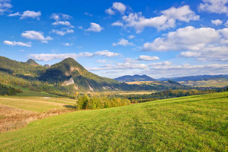 The Pieniny Mountains landscape, Carpathians, Poland  Daylight scenery with trees, meadows, mountains and clouds on the blue sky  Banco de Imagens