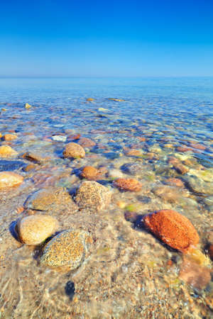 baltic sea: Beautiful seascape with coastal stones in the ocean  The Baltic coast, mediterranean sea, Poland  Clear fresh water
