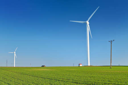 Windmill turbine on blue sky  Wind energy  Modern green power in rural environment Banco de Imagens - 29394672