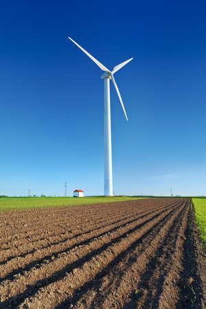 Windmill turbine on blue sky  Wind energy  Modern green power in rural environment Banco de Imagens - 29394673