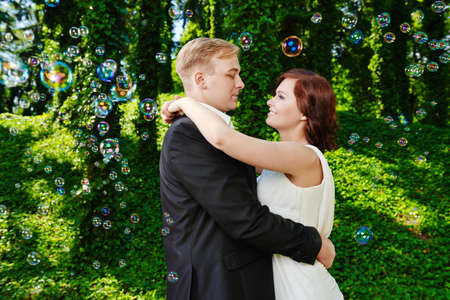 Newlywed couple hugging and looking into each eyes lovingly  Wedding love day