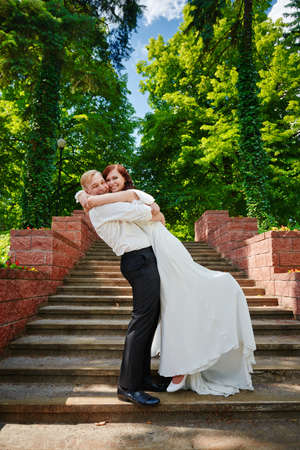 Newlywed couple are hugging and smiling  Wedding love day