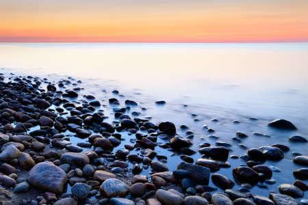 Sunset ocean coastal stones abstract background  Baltic coast, mediterranean sea, Poland  Banco de Imagens
