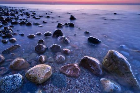 Purple sunset ocean coastal stones  Baltic coast, mediterranean sea, Poland