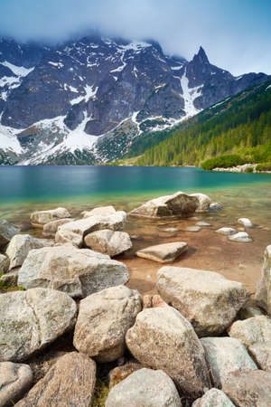 Stones at the shore of the Sea Eye Lake in the High Tatra Mountains. Carpathians Poland