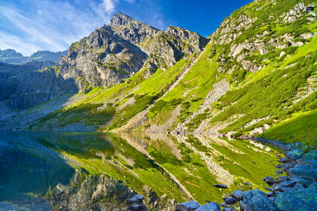 Beautiful nature landscape Gasienica Black Pond lake High Tatra Mountains Carpathians, Poland.