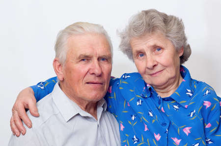 happy old couple looking to the camera. over white photo