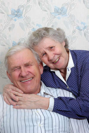 cries: happy old couple laugh until one cries Stock Photo