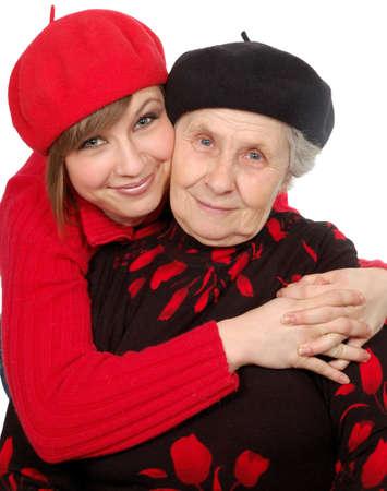 boinas: feliz abuela y nieta con boinas. aislada durante Blanco  Foto de archivo